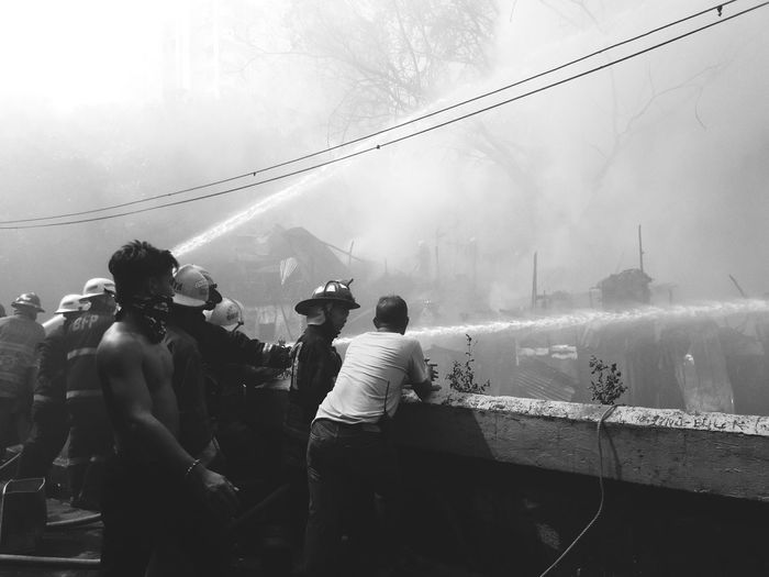 Firefighting Manila Firefighter Fire Streetphotography Outdoor Black And White Neighborhood Crowd Water Arts Culture And Entertainment Men