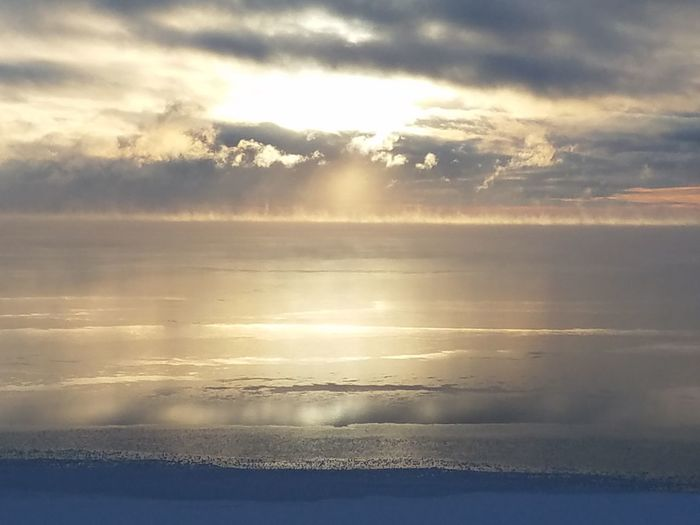 Frozen lake Cloud - Sky Water Reflection Nature Sunlight Beauty In Nature Sky Outdoors Cold Temperature Frozen Lake Mille Lacs Lake Nature Sunrise Over Lake Winter Wonderland Steam Risisg As Lake Freezes
