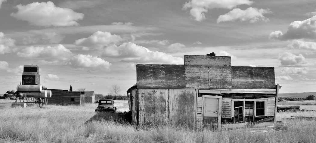 Abandoned Abandoned Buildings Abandoned Places Antique Architecture Backroads Blackandwhite Bnw Building Exterior Built Structure Canada Cloud - Sky Day Farm Truck Field Ghost Town Grain Elevator Grass Monochrome Nature No People Outdoors Prairie Railway Sky
