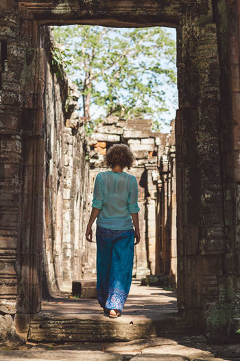 Siem Reap Cambodia Angkor Curly Hair Girl Rear View One Person Full Length Architecture Casual Clothing Walking Day Travel Adult Leisure Activity Women Built Structure Tree Real People Direction Standing Outdoors Tourism Travel Destinations Looking At View Hairstyle A New Beginning