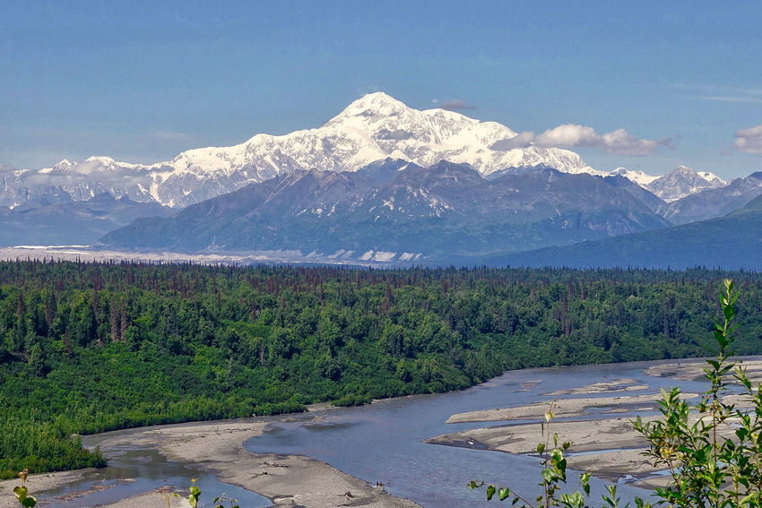Mount Denali in Alaska in the USA. Mount Denali USA Alaska Beauty In Nature Clouds Day Forest Landscape Mountain Range Mountains Nature No People Outdoors Range River Scenery Scenics Sky Snow Tranquil Scene Tranquility Tree Water
