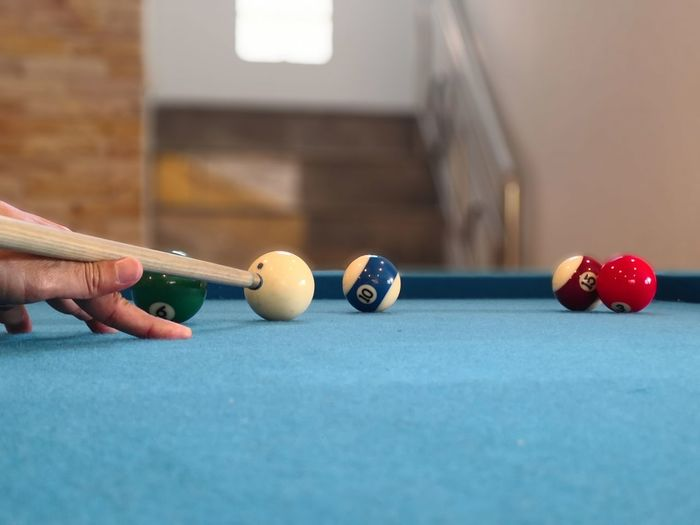 Close-Up Of Hand Playing Pool