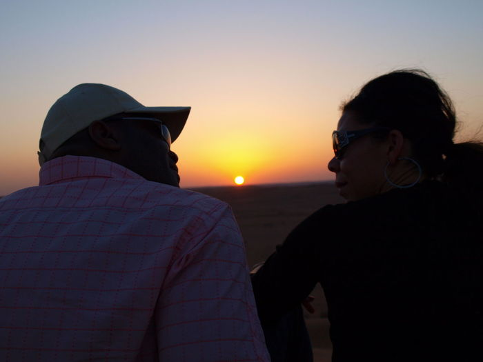 Beauty In Nature Bonding Desert Sunset Mahgreb Rear View Romantic Sky Sunset Togetherness Two People Connected By Travel