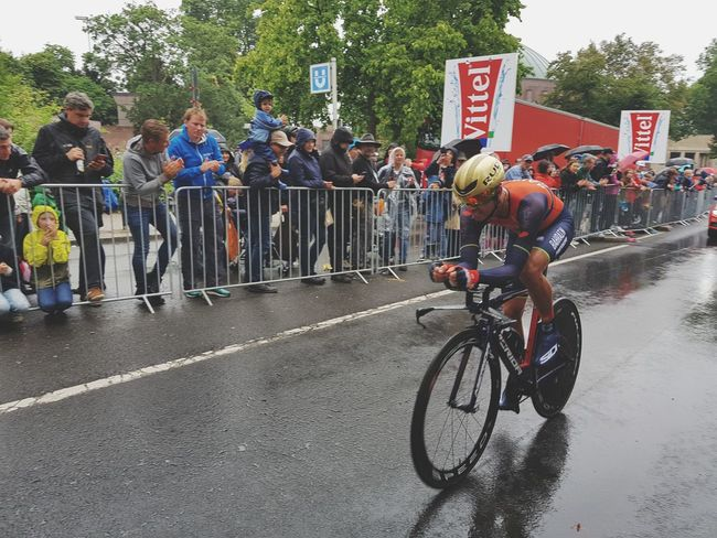 Speed Bicycle Cycling Large Group Of People Mode Of Transport Men Sports Race Cycling Helmet Racing Bicycle Transportation Day Participant Headwear Sport People Outdoors Real People Competition Adult Tree Biker Fun Tour De France Tourism Watching Rainy This Is Masculinity