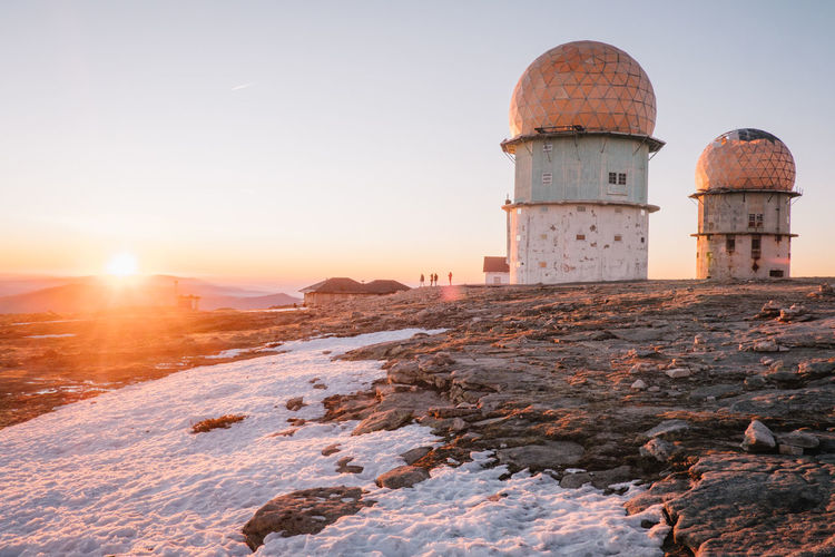 Architecture Astronomy Beauty In Nature Building Exterior Built Structure Day Dome History Landscape Manteigas Nature No People Outdoors Sky Snow Sun Sunlight Sunset Travel Destinations