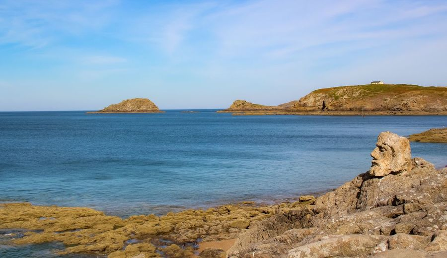 Sea Sky Water Beach Land Scenics - Nature Rock Beauty In Nature Nature Rock - Object Solid Tranquility Horizon Over Water No People Outdoors Blue Rock Formation Tranquil Scene