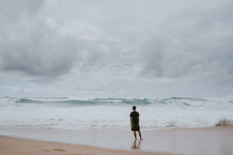 Adult Beach Beauty In Nature Cloud - Sky Day Full Length Horizon Over Water Leisure Activity Men Nature One Man Only One Person Only Men Outdoors People Power In Nature Real People Rear View Rough Scenics Sea Sky Standing Water Wave