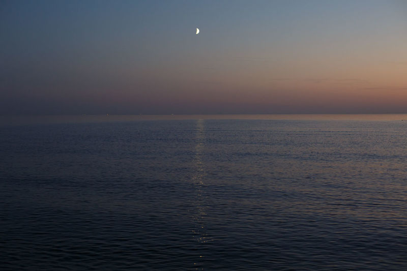 Sea Sky Scenics - Nature Water Beauty In Nature Horizon Over Water Tranquil Scene Horizon Tranquility Waterfront Sunset Idyllic Moon No People Nature Dusk Cloud - Sky Non-urban Scene Rippled Outdoors