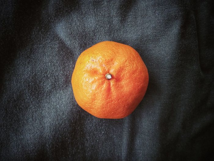 High angle view of orange on black background