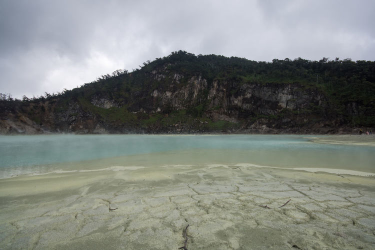 The Sulfur Lake at White crater or Kawah Putih in Ciwidey West Java, Near Bandung city, Indonesia Water Beauty In Nature Tranquility Sky Scenics - Nature Tranquil Scene Nature No People Cloud - Sky Mountain Non-urban Scene Day Lake Rock Rock - Object Travel Destinations Landscape Solid Geology Outdoors Hot Spring Power In Nature Lagoon