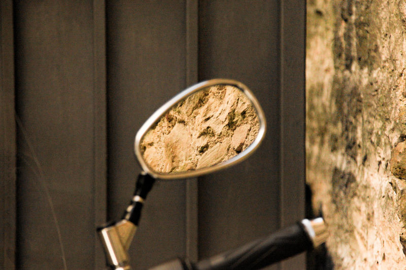 rear mirror of a motorcycle with a rock wall that reflects Cycle Mirror Motorcycle Reflection Rock Wall Rückspiegel Spiegel Spiegelung Close-up Focus On Foreground Leisure Motorcycles Motorrad No People Old Timer Rear Mirror Rear-view Mirror Rock Wall Texture Still Life