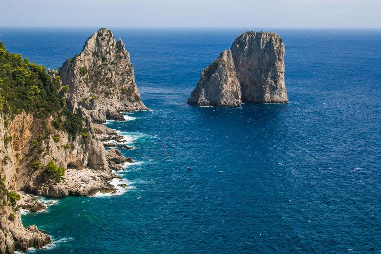 Panoramic View Of Rocks In Sea Against Sky