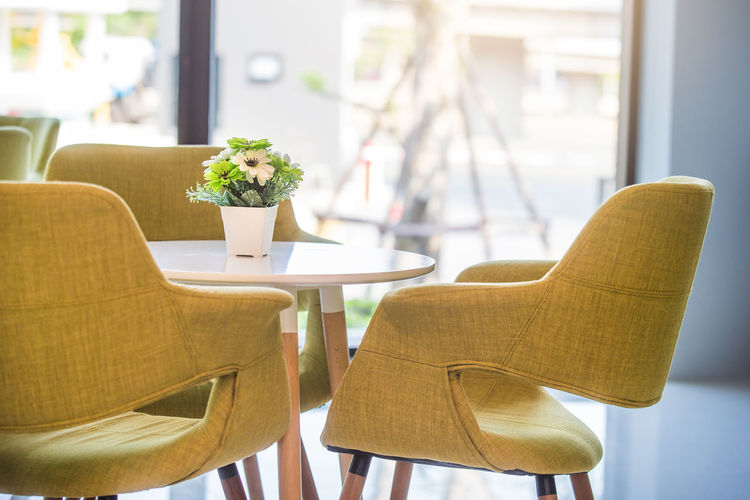 Close-Up Of Empty Chairs And Table Arranging At Restaurant