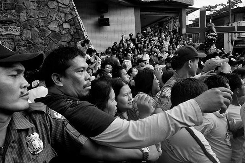 ​Deployed Police men and Marshalls in Black Nazarene Traslacion trying to stop devotees from reaching the Jesus Nazarene's carriage while the replica is being lifted inside into the Jesus Nazarene Church, CagayanDeOro City, Philippines , on January 9, 2016.  Everydayphilippines Everydayasia Everybodystreet Streetphotography Streetphotographer Photojournalism Photography Art VisualArt  Mamamcollective Documentaryphotography LCExposure Traslacion2016 BlackNazarene Kalyegraphy Ig_pilipinas LitratongPinoy LitratistaSaDaan