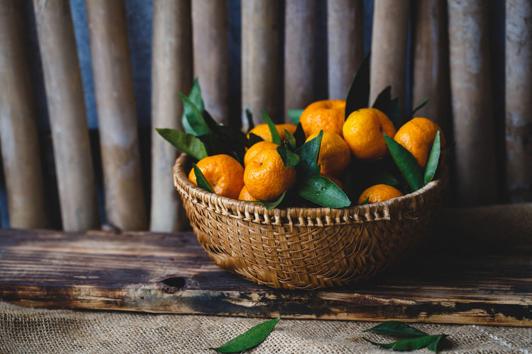 High angle view of oranges in basket
