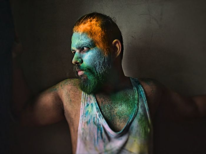 Tri color of indian flag on bearded man side faced portrait