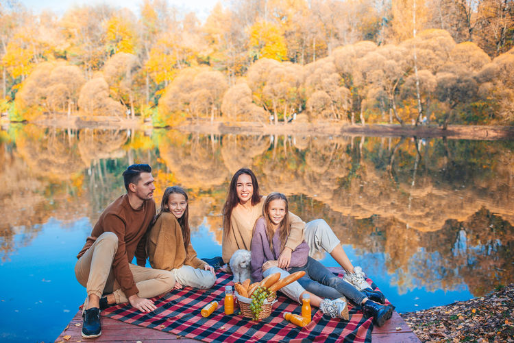 High angle view of people sitting at forest during autumn
