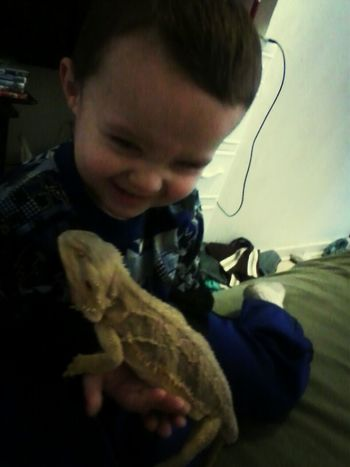 his first time holding the lizard Check This Out That's Me Cheese!