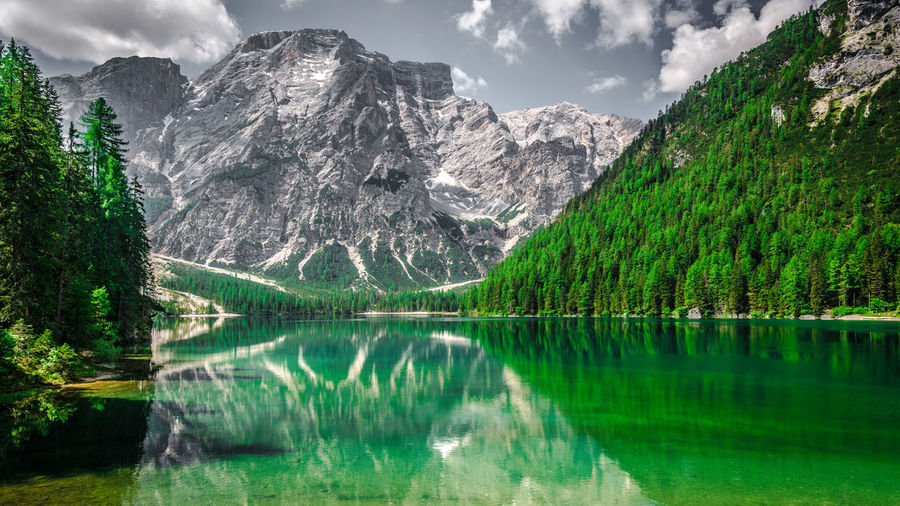 Scenic view of lake pragser wildsee and mountains against sky