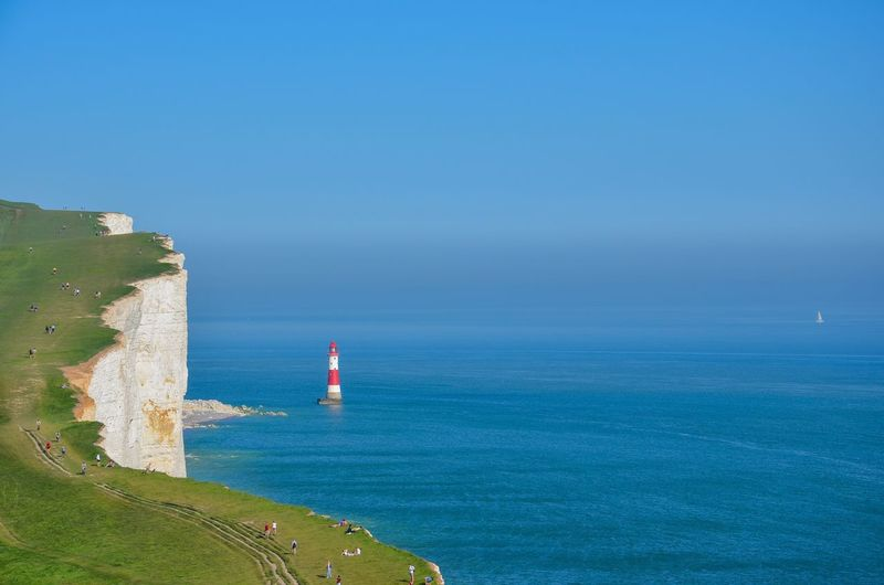 Beyond The Cliff Horizon Over Water Sailboat Seven Sisters Cliffs Seven Sisters White Cliffs  Cliffs Sea Water Horizon Over Water Beauty In Nature Horizon Scenics - Nature Blue Sky Nature Land Tranquil Scene Tranquility Lighthouse Built Structure Non-urban Scene Outdoors Day The Great Outdoors - 2018 EyeEm Awards
