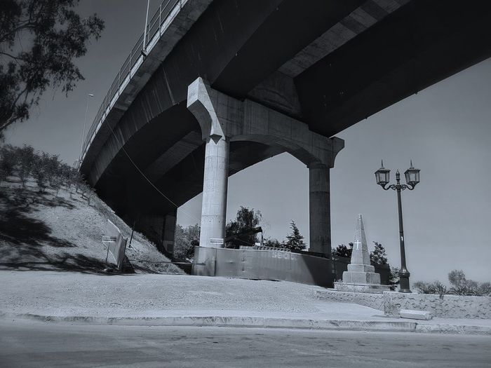 Tried Tried Something New  Connection Connection Life City Check This Out Streetphotography Bridge Monument Cross Welcome To Black Low Angle View Architecture EyeEm Best Shots Built Structure Outdoors EyeEm Best Edits No People Nature Sky Cold Temperature Building Exterior Blue Tint