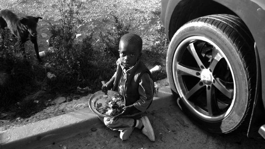 Untold Stories Boy Kid Hello World Eating Floor Dog Africa Africa Angola