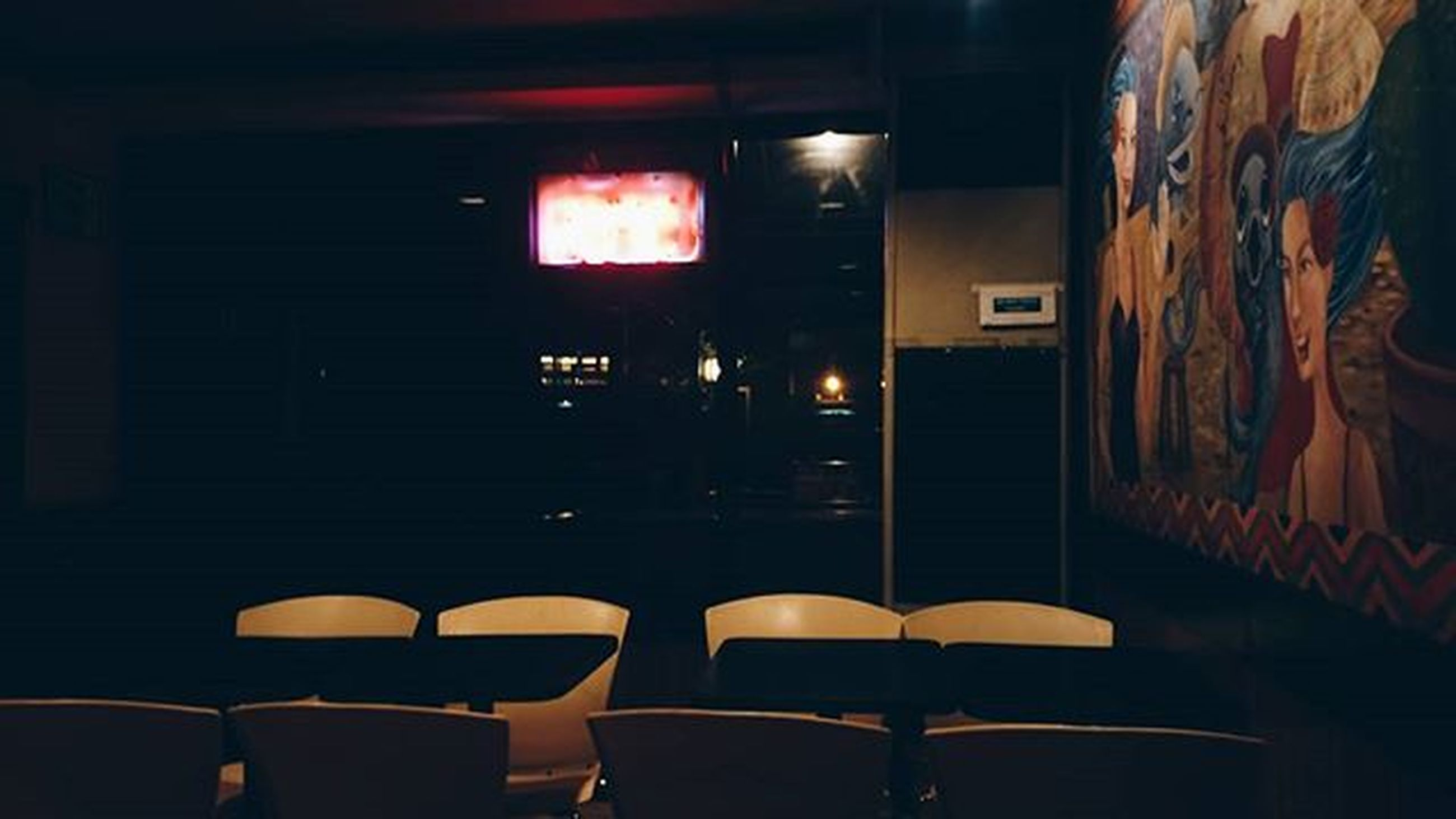indoors, illuminated, chair, built structure, window, absence, architecture, lighting equipment, empty, wall - building feature, wall, night, in a row, dark, no people, interior, room, store, restaurant, seat