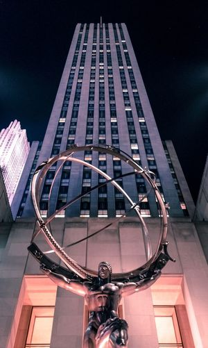 Atlas statue at night Transportation Bicycle Architecture Built Structure Outdoors No People Day Building Exterior City Sky