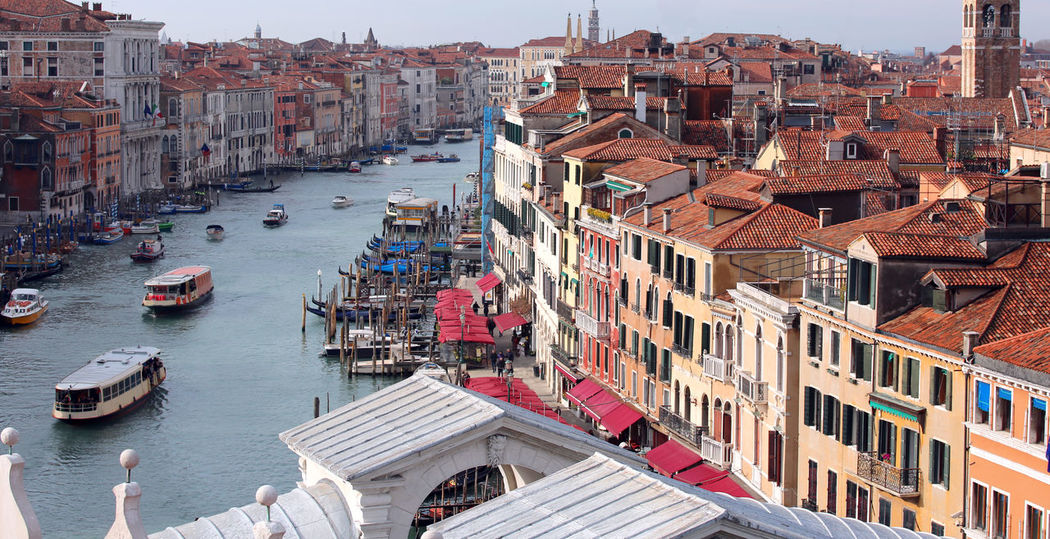 Venice Italy Grand Canal and Rialto Bridge with many boats from an unusual view #VENEZIA #Venice Architecture Canal Grande Drone  European Birds Grand Canal Place Rialto Bridge Venetian Venezia Venice Beach Venice, Italy Aerial View Island Italian Italy Outdoor Outdoors Palace Ponte Di Rialto Rialto Sestiere Veneto Venice