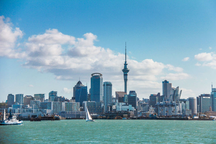 The Skyline of Auckland New Zealand Auckland Auckland New Zealand Auckland City Auckland Skyline Architecture Built Structure Building Exterior City Building Sky Water Tower Travel Skyscraper Tall - High Office Building Exterior Travel Destinations Cityscape Transportation Cloud - Sky Spire  Waterfront Urban Skyline No People Outdoors Modern Financial District