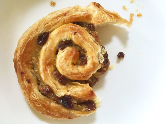 Breakfast Breakfast Painauraisin Pastries Crumbs Halfeaten Raisins Danish Pastry Foodporn Foodphotography IPhoneography Swirl Eating Hungry Meal Snacktime Bakery White Background