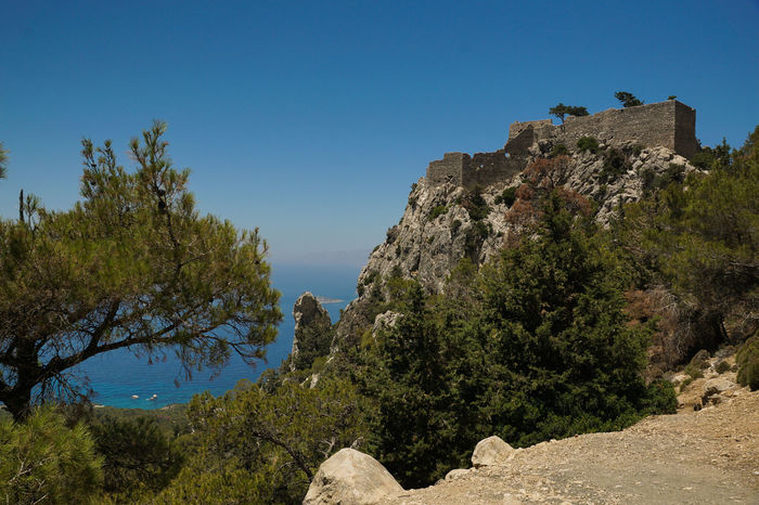 Architecture Beauty In Nature Blue Clear Sky Day Fortress Landscape Monolithos Monolithos Castle Mountain Nature No People Outdoors Rhodes Ruins Scenics Sky Tranquility Travel Travel Destinations Tree