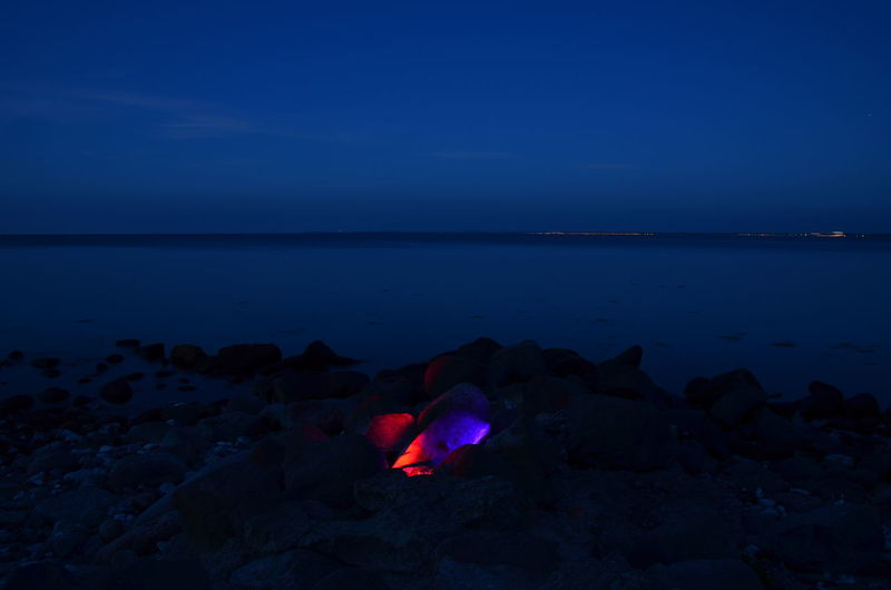 Colorful Stones Sea Horizon Over Water Beach Night Sky Illuminated No People Multi Colored Water Scenics Abstract Blue Red