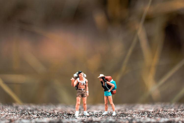 Figurines of hikers on walkway