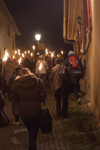 Illuminated procession at the Christmas market in Esslingen Dark Esslingen Red Road Unrecognizable People Winter Architecture Built Structure Cobblestone Cold Temperature Cropped Festival Fire Historic Buildings  Illuminated Illuminated Procession Lamp Lifestyles Night Outdoors People Real People Togetherness Torches Warm