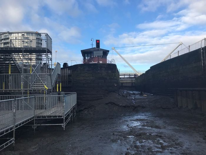Inside the drained Leeds Dock during work to replace the lock gates. Waterway Man Made Construction Industry Low Level Shot Man Made Urban Construction Dock Sky Cloud - Sky Built Structure Architecture Building Exterior No People Day Industry Outdoors