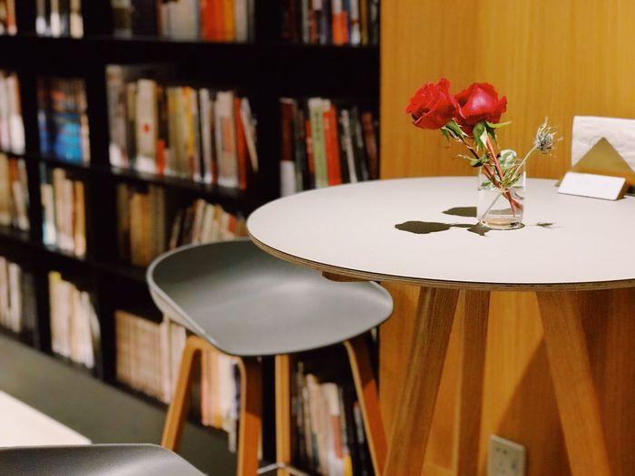 Roses Bookstore Indoors  Table Flower No People Flowering Plant Freshness Still Life Seat Vase Plant Shelf