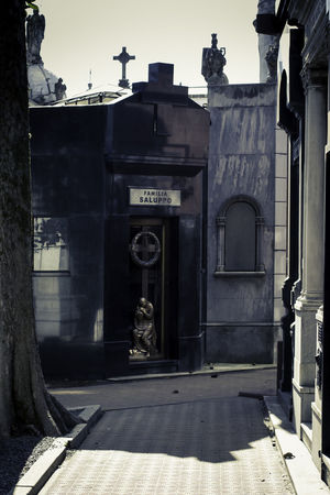 La Recoleta Cemetery, Buenos Aires, Argentina Upper class death in Argentina. The myriad of tombs and mausaleums open to the public housing the wealthy and famous of Argentine society. A macabre place of death and celebration. The Photojournalist - 2018 EyeEm Awards Architecture Building Building Exterior Built Structure City Communication Day Entrance History Human Representation Nature No People Outdoors Sculpture Statue Street Sunlight Text The Past Travel Destinations