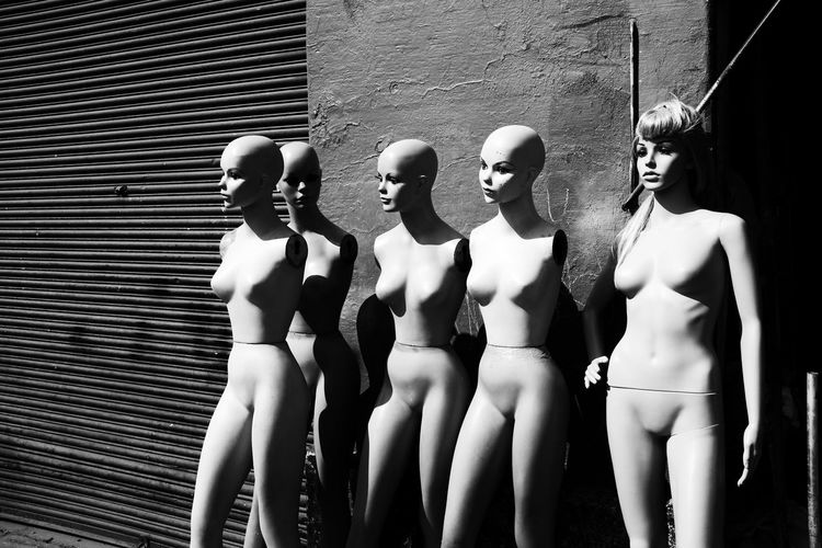 Mannequins by building on sunny day