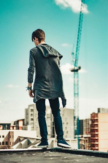 Full Length One Person Built Structure Architecture Real People City Casual Clothing Building Exterior Rear View Lifestyles Sky Outdoors Day Leisure Activity Young Adult Young Men Men Standing Skyscraper Businessman The Week On EyeEm