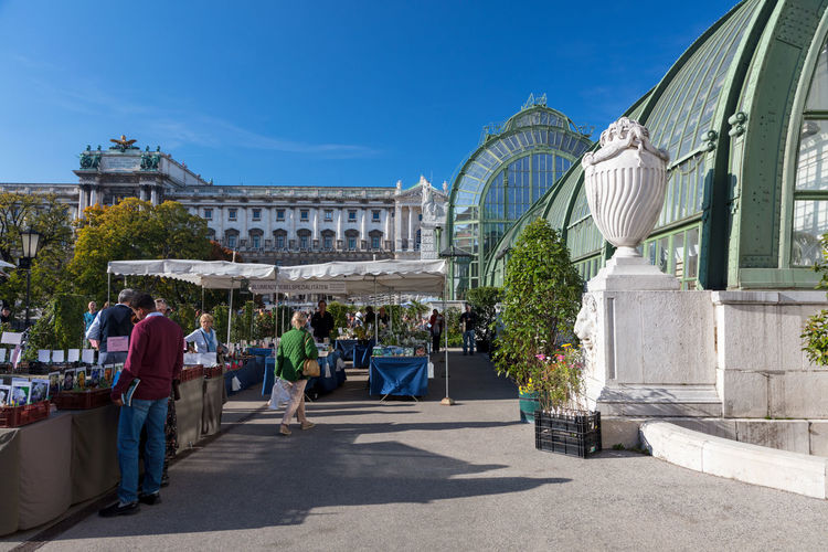 Palmenhaus in Vienna at Hofburg Architecture City Clear Sky Growth Historical Building Palmenhaus Plants Travel Blue Sky Building Building Exterior Built Structure Fassade Glass Real People Steal Sunshine Travel Destinations Wien