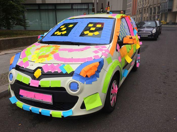 Multi colored car on road