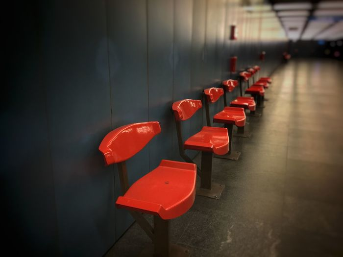 Empty Red Chairs Against The Wall