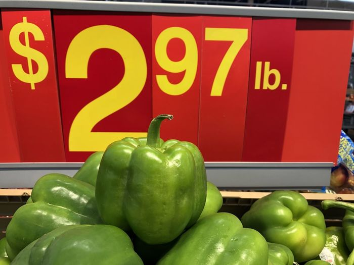 Green bell peppers for sale at market stall