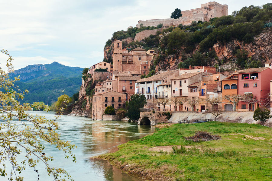 Miravet village and Ebro river. Province of Tarragona. Spain. Miravet is one of the most charming village in Catalonia Ancient Architecture Beauty In Nature Castle Catalonia Cloudy Sky Coastal Elbe River Famous Place Fortress Hillside Houses Landmark Landscape Miravet, Spain Nature Nobody Old Town Picturesque Rocky Mountains Scenery SPAIN Tarragona, España Travel Destinations Village Waterside