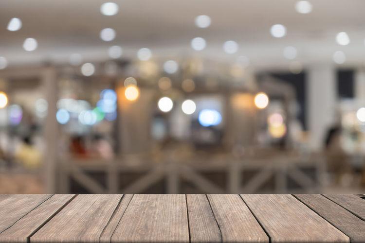 Defocused image of illuminated lights on table at night