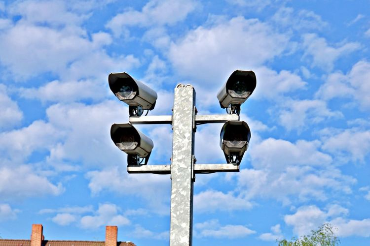 Sky Low Angle View No People Sign Communication Safety Technology Outdoors Surveillance Camera Big Brother Is Watching You Quad Eye Pole Guidance Metal Street Video Cameras