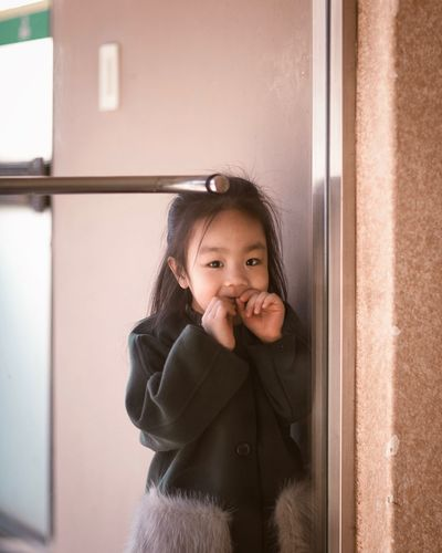 Portrait of girl seen through window