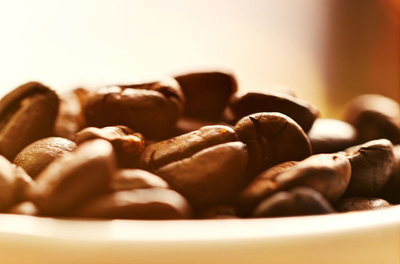 Close-up of roasted coffee beans in bowl