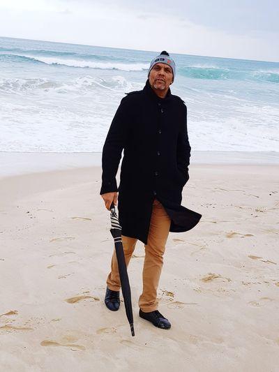 Full length portrait of man walking at beach